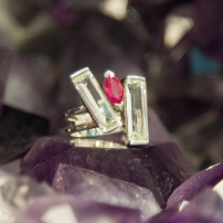 Ruby ring with a bar of Clear Quartz on both sides.