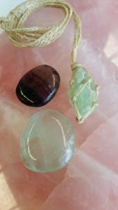 Variation f Fluorite flat stones. Natural fluorite pendant